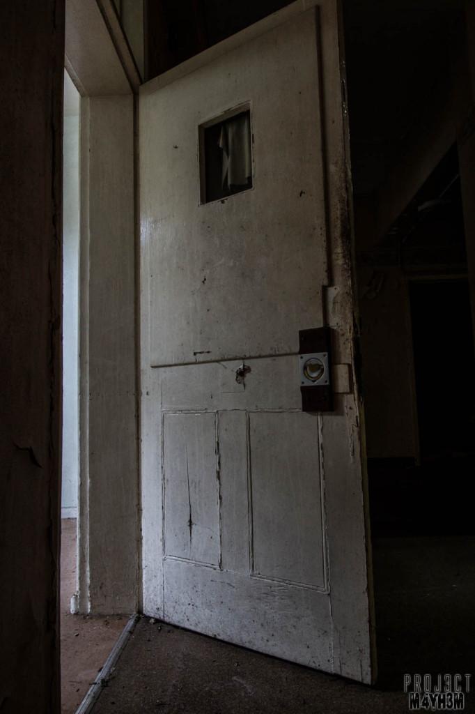 OM Asylum Cell Door